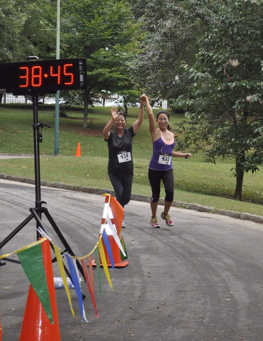 Ashley Hyun and her mother celebrate crossing the drawchange 5K finishline!