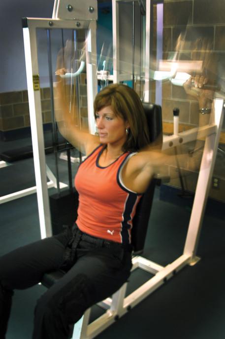 Girl doing shoulder presses