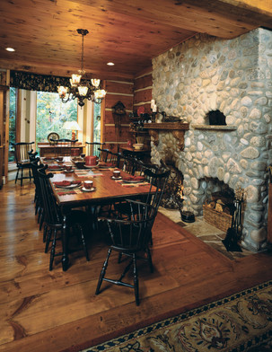 Log cabin witha stone fireplace