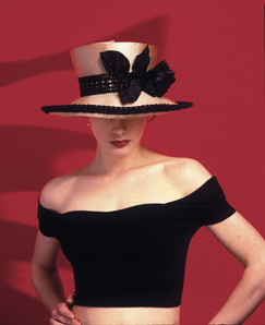 Girl wearing designer hat