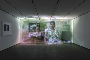 Christopher Kulendran Thomas in collaboration with Annika Kuhlmann, Being Human, 2019. Digital projection on acrylic.