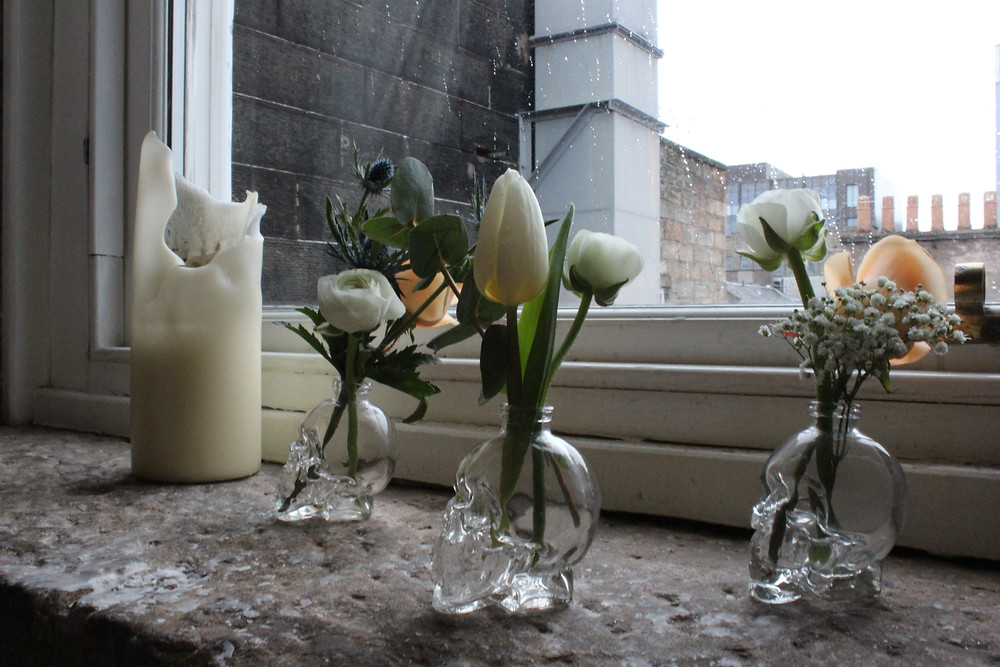 Skull vases as wedding centrepieces