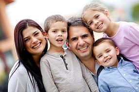 Five member family portrait looking happy.jpg
