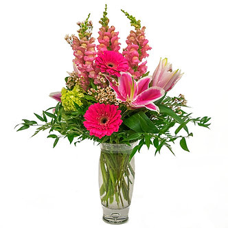 Pink Hybrid Lilies mini green Hydrangeas pink Snapdragons bright pink Gerber Daisies and light pink Waxflower
