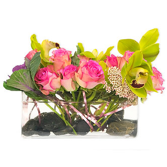 pink and greens features rice flower kale short stem roses and a massive cymbidium orchid