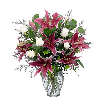 Oriental lilies with white roses