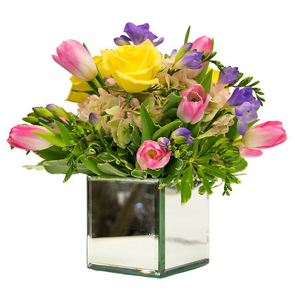 Yellow Roses pink/green hydrangea light pink/white Van Dyke Tulips and purple Freesia in a mirrored cube