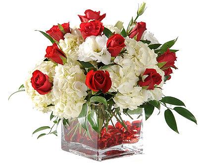 red Sweetheart Roses white Hydrangea and white Freesia