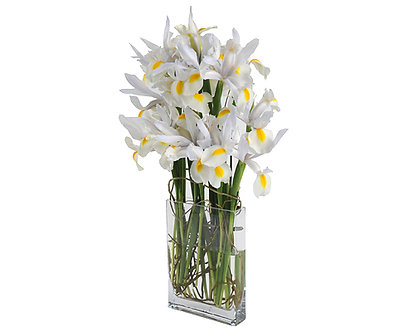 white iris and curly willow in a tall narrow vase