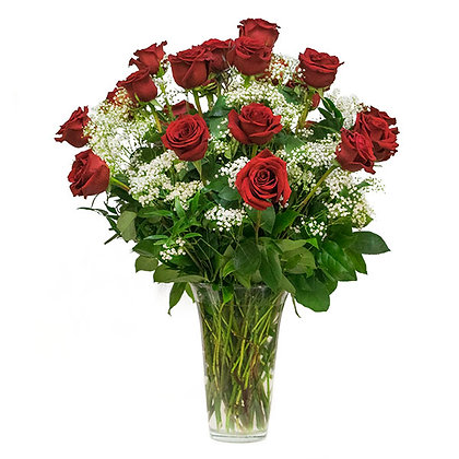 Two dozen classic red roses arranged in a vase