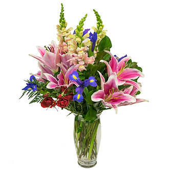 red Spray Roses and blue Irises with pink Snapdragons and Lilies