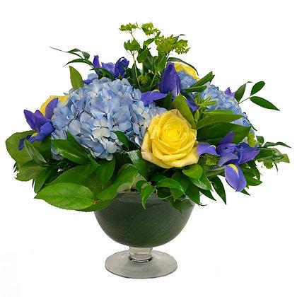 Blue and yellow irises blue hydrangeas and yellow roses