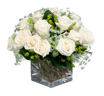 Hypericum Queen Anne's lace & creamy roses mixed creatively in a clear square vase