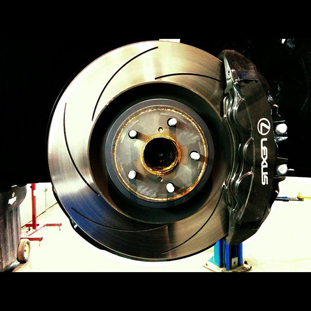 Slotted Brembo brake rotor, pads and oversized caliper on a late model Lexus RC-F sports car.