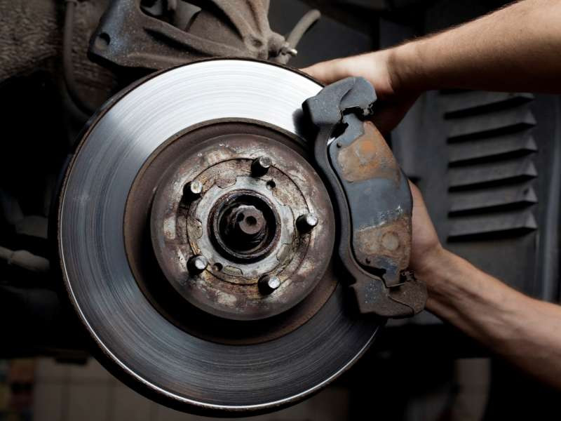 A proper way of inspecting brakes is to remove the caliper and check the amount of friction material left on both inboard and outboard brake pads. The movement of slider pins, brake cylinder and pads in its bracket can also be inspected at the same time. The thickness and condition of the brake disc should also be noted.