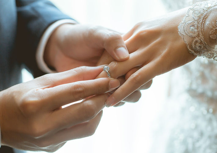 Wedding ring being placed on bride's hand.jpg