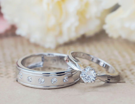 Diamond and white gold wedding ring and engagement ring