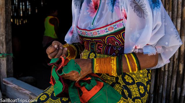 Kuna women make the Mola