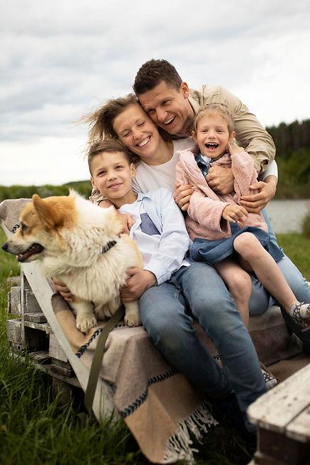 full-shot-happy-family-nature.jpg