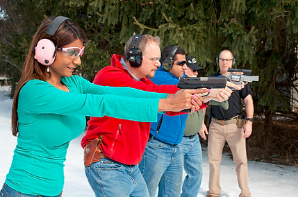 Firearm safety class taught by Safe and Secure Training of CT, LLC. Men and woman learning proper stance and grip in Milford CT. Men's and women's pistol classes available at www.safeandsecuretraining.com