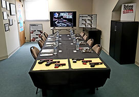 Connecticut Concealed Carry classroom with textbooks and practice pistols