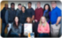 NRA Instructor & smiling basic pistol students