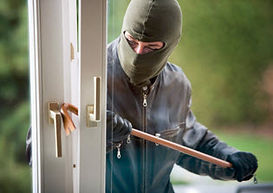 Burglar breaking door. Refuse to be a victim with Safe and Secure Training
