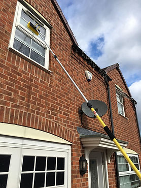 Yellow Hose Window Cleaning Pole 1.jpg