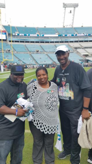 Jordan's bro and his wife at Jaguars game