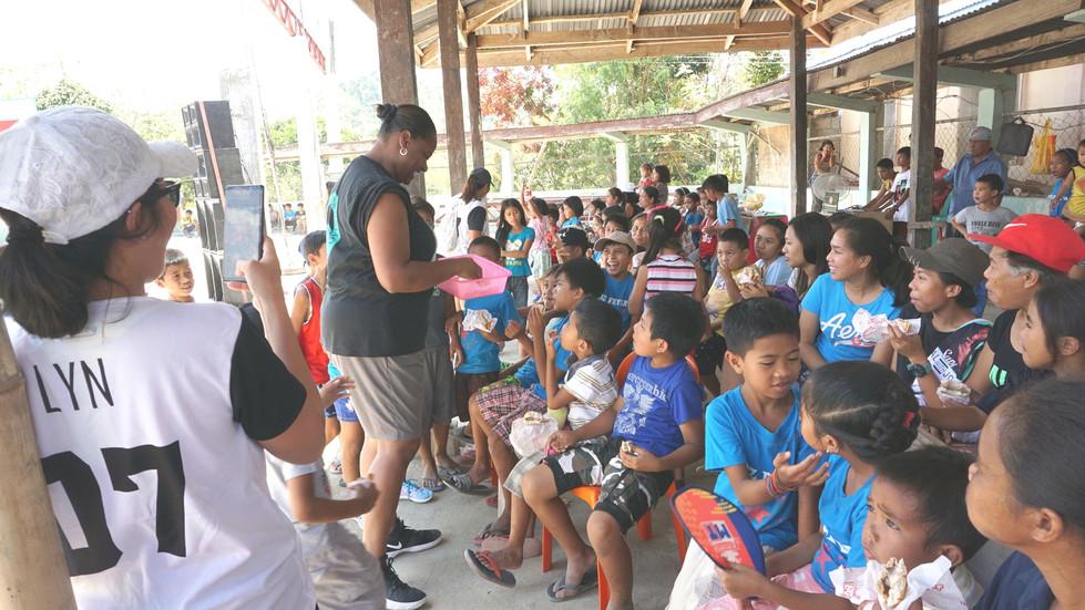 Officer Lakesha Burton serving Filipino kids