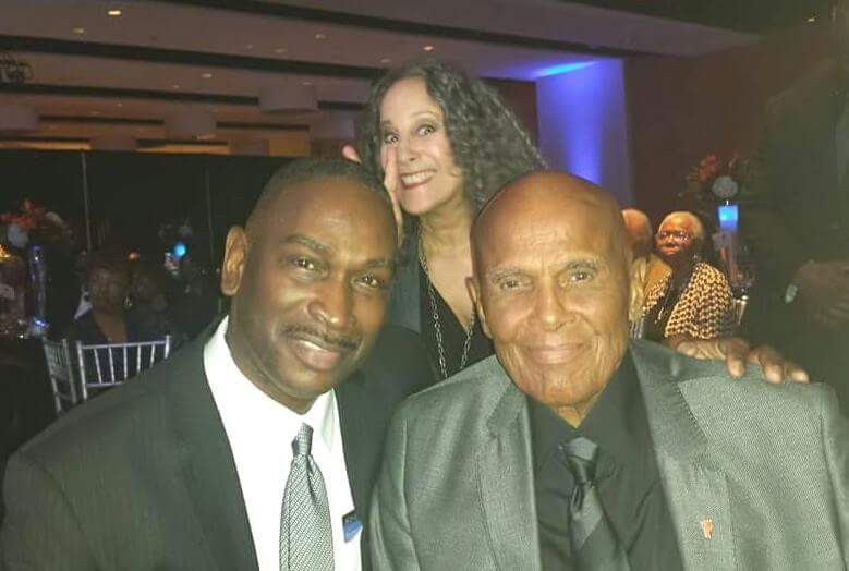 With actor Harry Belafonte plus daughter