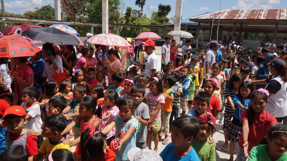 Filipino children waiting patiently for food and supplies