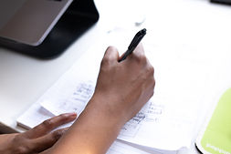 Girl writing on paper - 2560x1707.jpg