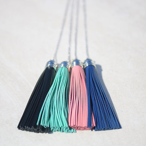 Long silver necklace with leather tassel