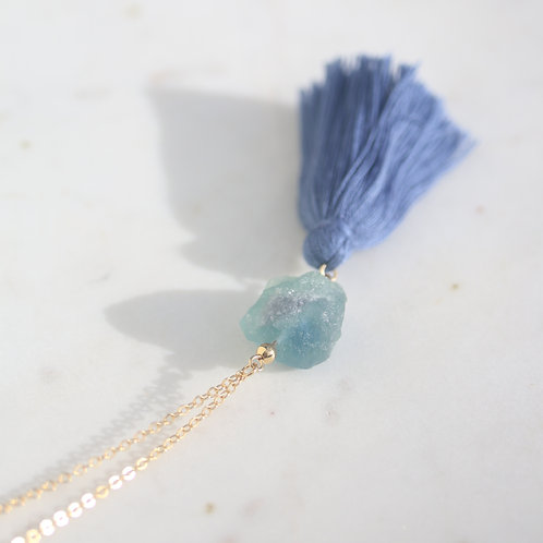 Raw fluorite crystal with purple tones on gold chain