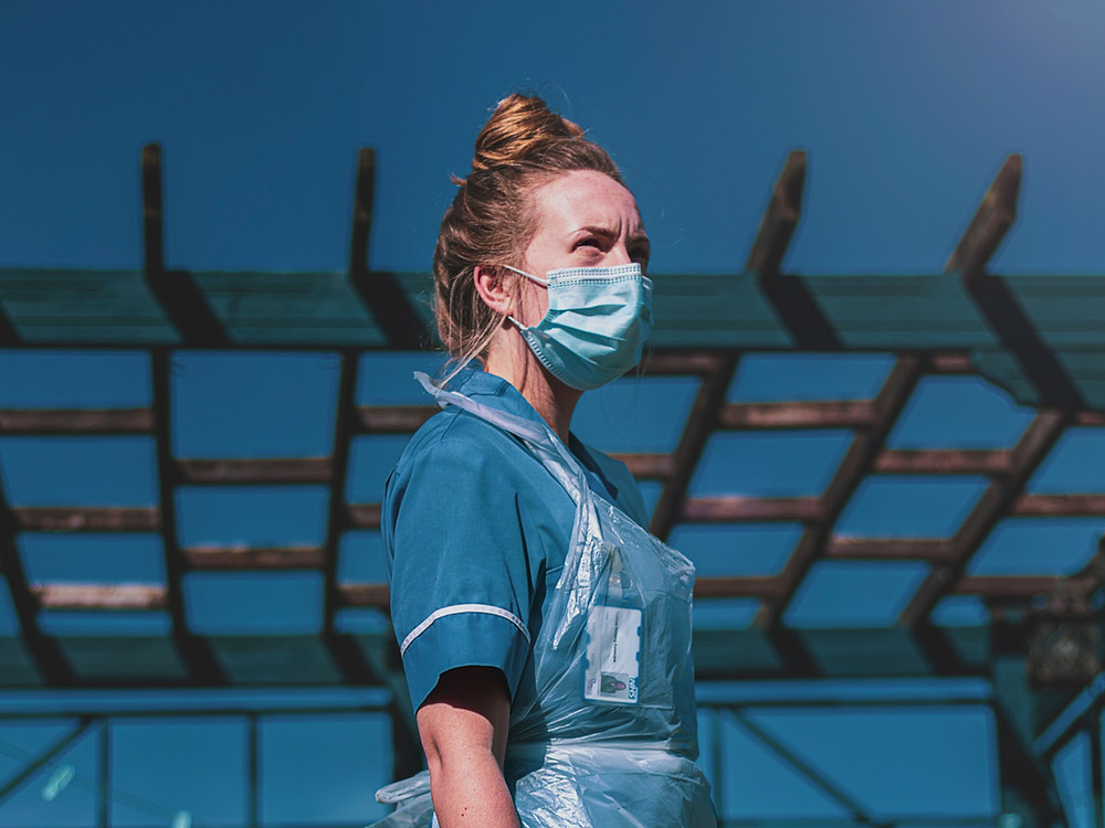 Image of NHS nurse with COVID-19 PPE