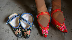 Image of foot binding shoes