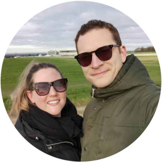 Image of man and girlfriend smiling at camera