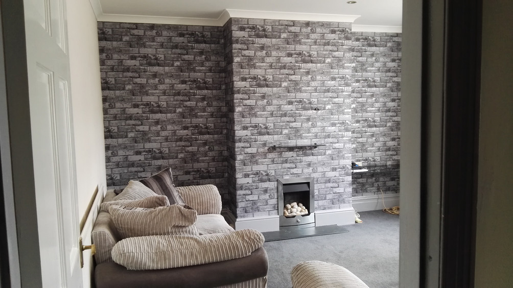 Lounge feature wallpapered wall