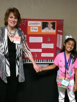 Jennifer Linn poster with student