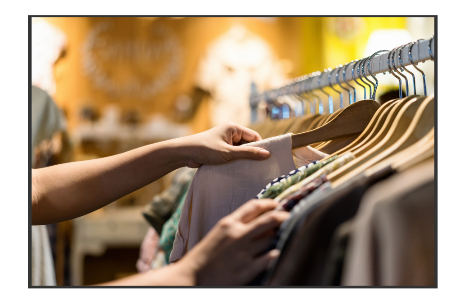 Photo of someone touching apparel in a retail store