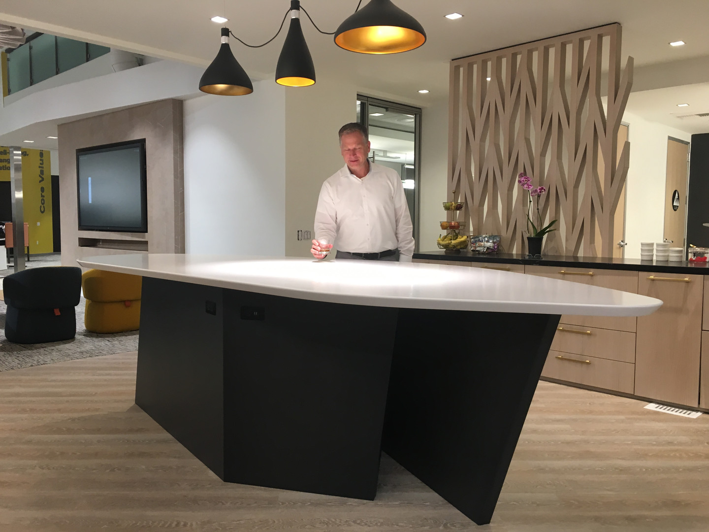 Cesarstone Hospitality Table with steelbase and integrated electrical powerblocks