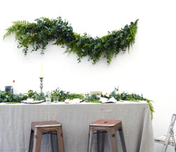 Faux green swag above table