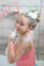 Girl painting with Fozzis Bath Paint