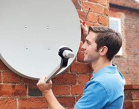 Man-Fitting-TV-Satellite-Dish-To-House-W