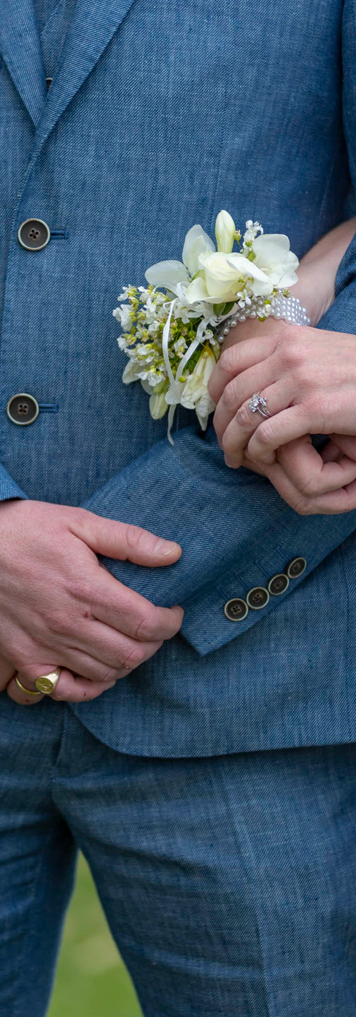 Blue linen wedding suit bride and groom white rose wrist corsage millinery summer suffolk