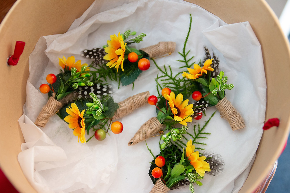 Summer buttonholes sunflowers berries greenery hessian twine happy colourful corsage headdress millinery