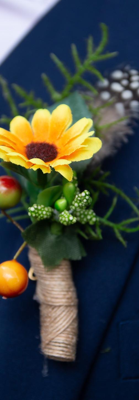 Dark blue cobalt wedding suit summer buttonholes sunflower berries feather greenery happy corsage headdress wedding suffolk