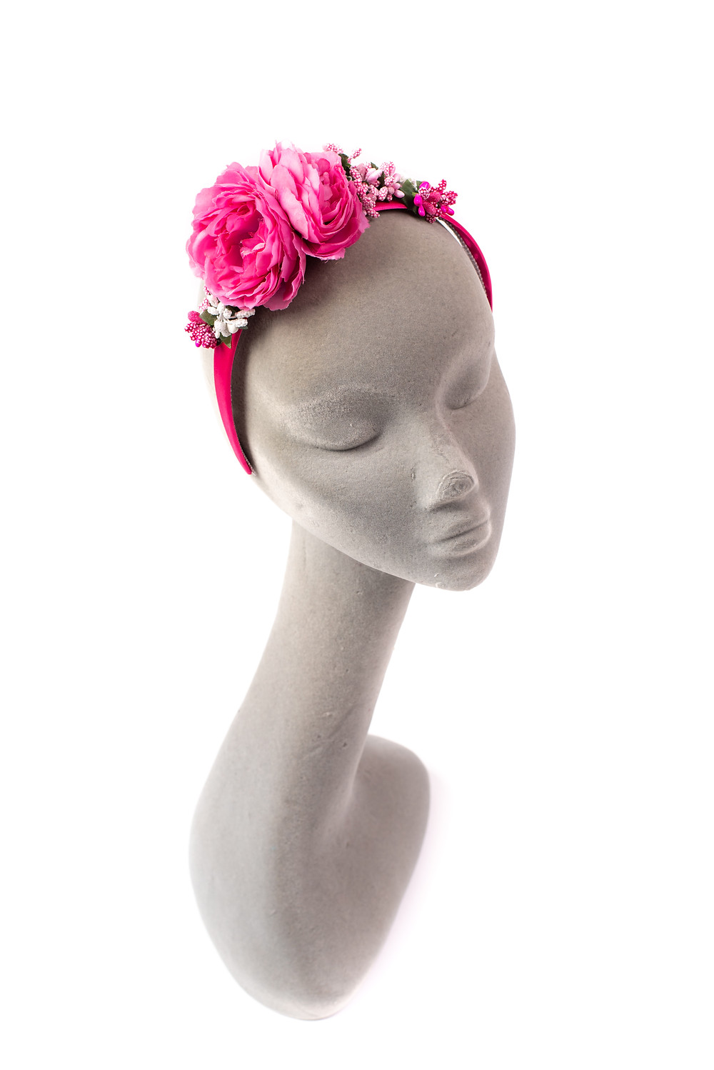 A pretty hair decoration of Pink Peonies, and dainty pink and white buds, set onto a pink satin hair band. Perfect for a summer ball or wedding.