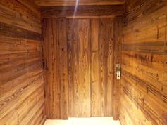 porte ascenseur faux vieux bois meribel.
